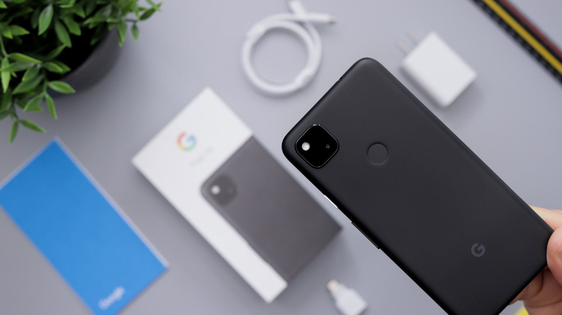 A Pixel 4a with the box