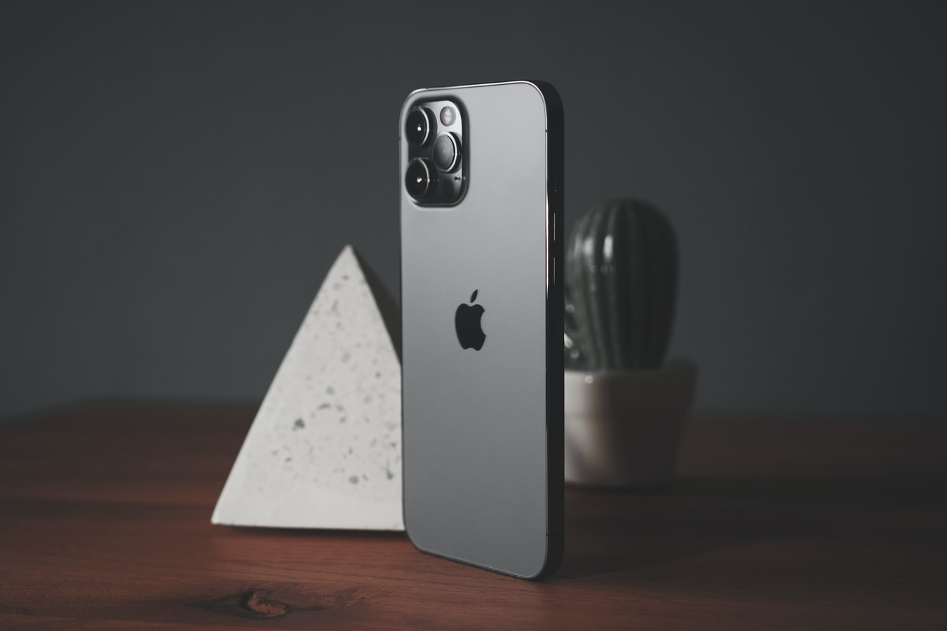 The iPhone 12 Pro Max standing on a table