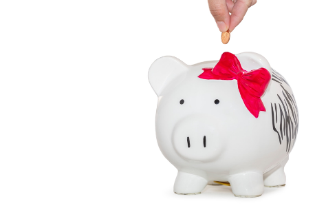 Person adding money to piggy bank