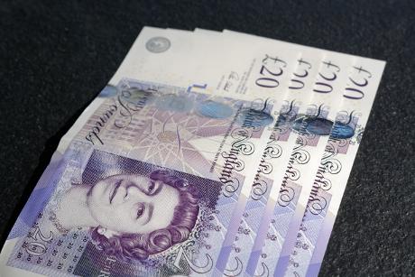 twenty pound notes spread on a table