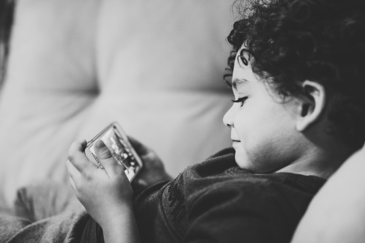 A child playing on his mobile phone