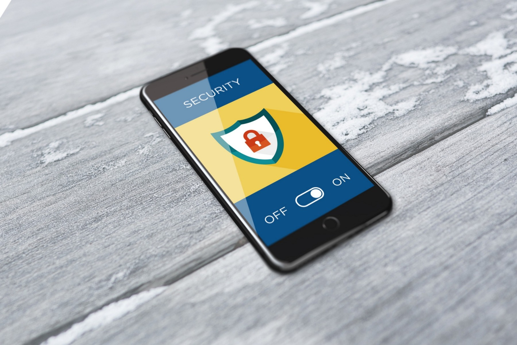 A phone with a security graphic on the screen